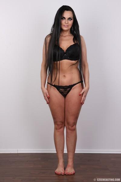Curvy mature brunette poses