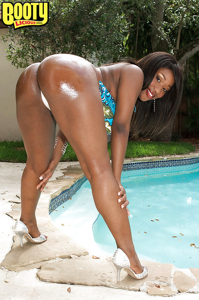 Black mom Janet Jade showing off bulky black ass outdoors beside pool