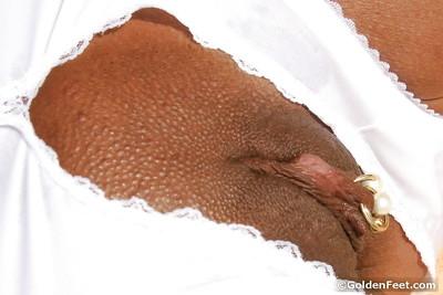 Naughty mellow UK dame Lady Sarah revealing pierced pussy lips