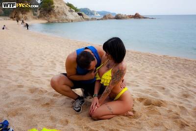 Tattooed Latin cutie MILF taking jizz flow in mouth after hardcore sex on beach