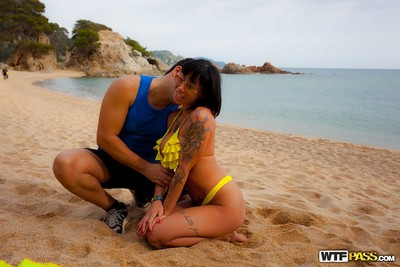 Tattooed Latin cutie MILF taking jizz flow in mouth after hardcore sex on beach