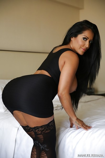 Chesty Latina MILF Kiara Mia letting huge knockers loose from clothing