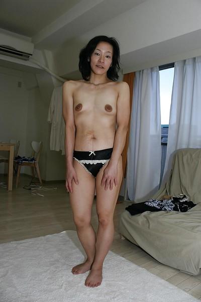 Naughty oriental MILF Aya Sakuma undressing and exposing her holes
