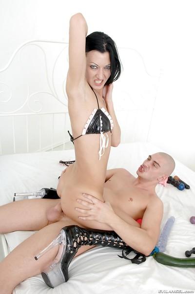 Slim brunette floozy on high heels is into hardcore anal pounding
