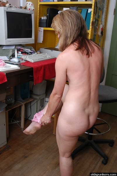 Mature office worker Linda pulling panties aside to bare hairy love-cage