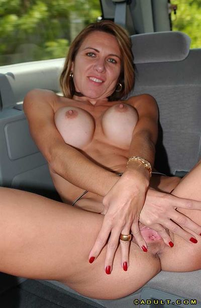 Sassy cougar makes public her goods and goes down on a lucky fellow in the car