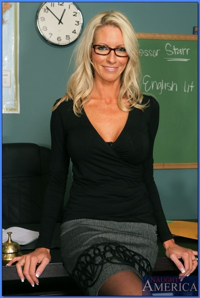 Seasoned teacher in glasses Emma Starr posing with tits and ass unveiled