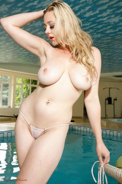 Busty blonde sapphire in her bikini in the pool