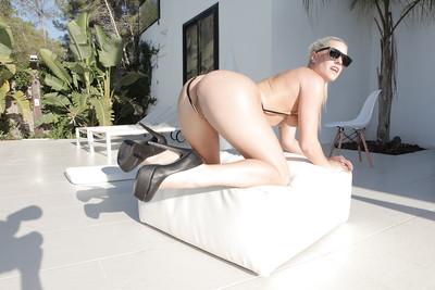 Sunglasses wearing Euro babe Blanche Bradburry strutting in high heels