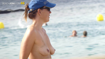 Topless mommy on the beach