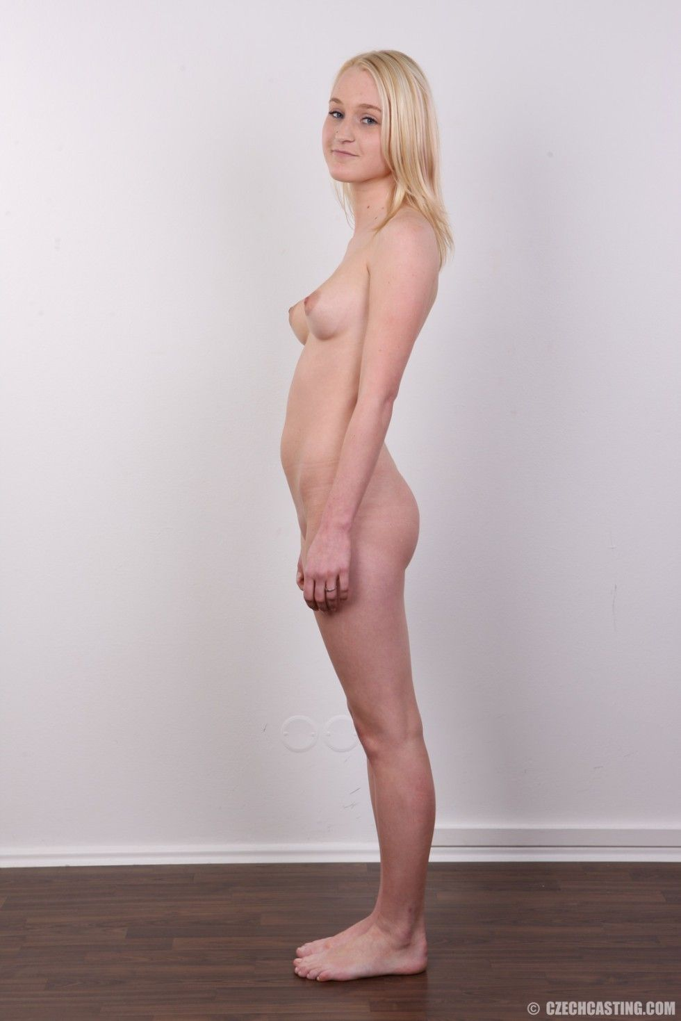 Diminutive blond youthful positions unclothed