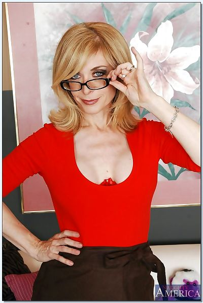 Sex-hungry melodious lassie Nina Hartley revealing her jugs and inviting twat