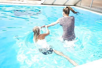 Topless fairy Sara J seduces her youthful girlfriend into girl-on-girl sex in pool