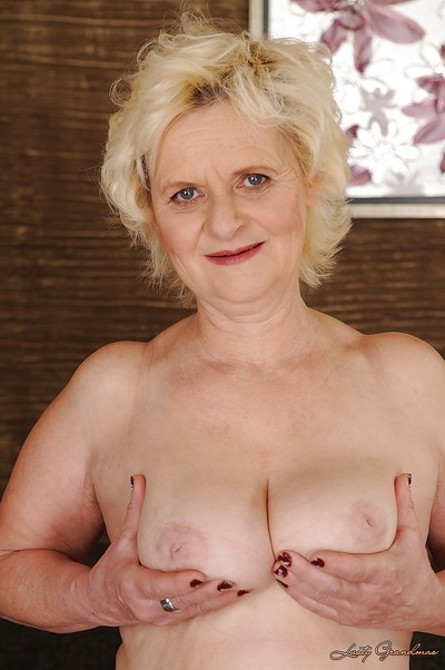 Curvy blonde granny with fatty a-hole obtains rid of her lacy underware