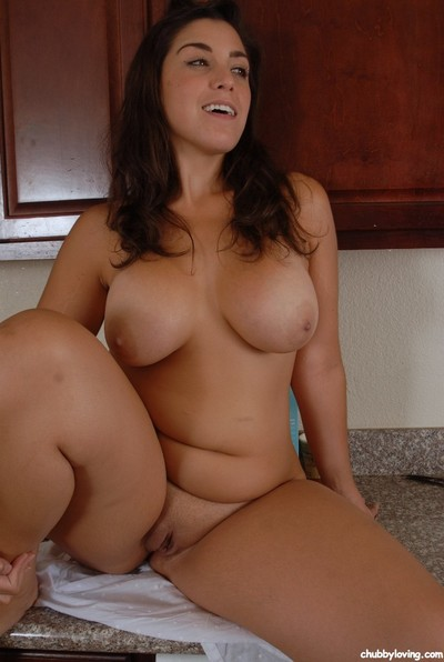 Latin chico BBW Leigh striking sexy topless solo model poses in pink underclothes