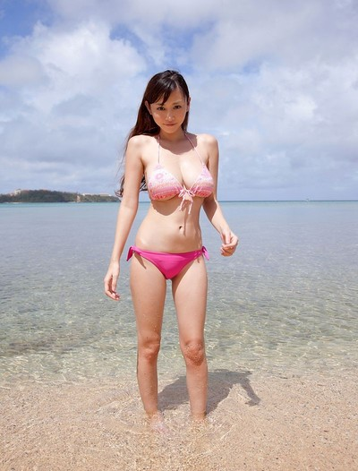 Busty asian anri sugihara at the beach in a pink bikini
