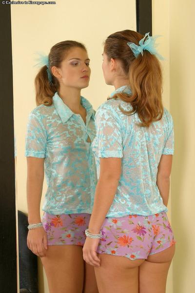 Beautiful amateur teen Monika is looking at herself in mirror