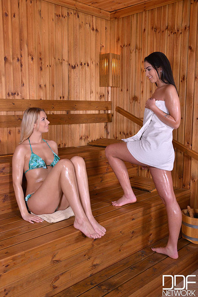 Hot and Steamy in the Sauna - Lesbian babes Wand at their Pinks