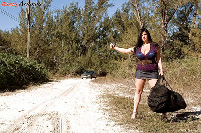 Massive melloned Arianna Sinn was hitchhiking in slutty outfit when she was picked up by handsome well hung dude.