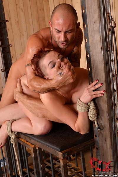Fetish model Leila Moon is suspended upside down for DP 3some in BDSM shoot