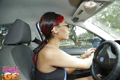 Amateur ebony chick in glasses flashes big tattooed woman passports in car