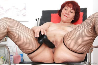 Fat woman Manka has intercourse her shaved puss using some medical appliance