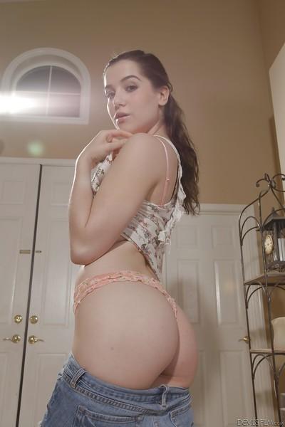 Young pornstar Kasey Warner posing covered in denim shorts earlier than stripping
