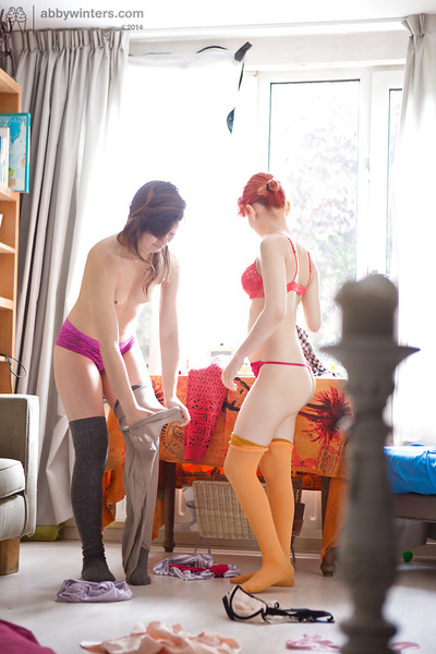 Hairy wet crack dykes Gala and Thais pull on long socks and panties after copulation