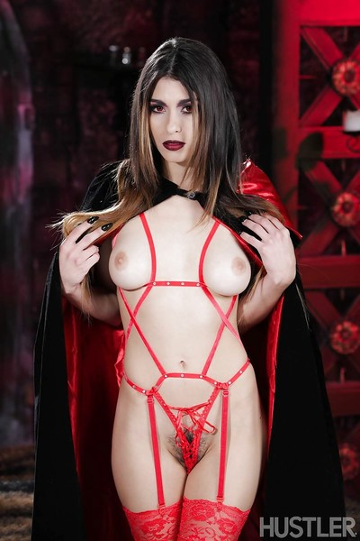 Pornstar Raven Rockette modelling in damp Goth look as if and outfit