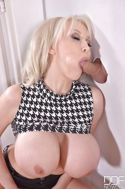 Buxom golden-haired Sandra Star getting chipmunked by big cock at gloryhole