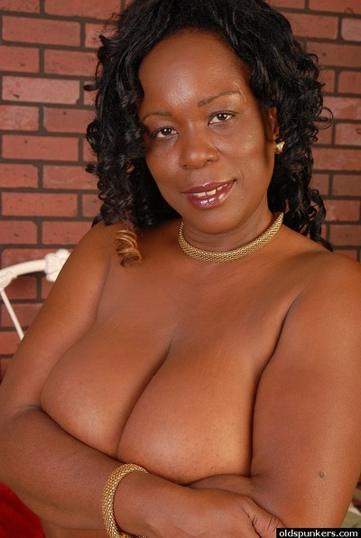Alluring kinky dark brown ebony Yvette shows her big common boobies