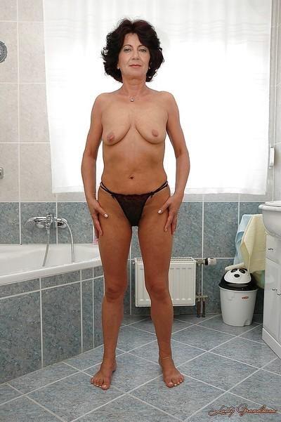 Seductive dark hair granny erotic dancing off her underware and taking a shower