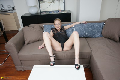 Appealing european housewife playing with herself on the couch