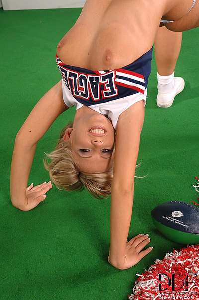 Blonde cheerleader babe Tiffany Rousso exposing big all accustomed tits
