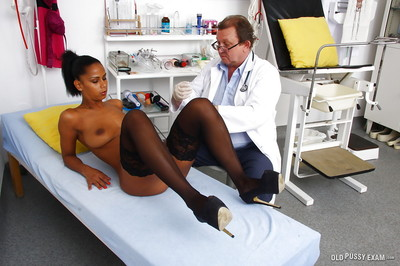 Leggy Lalin girl honey in stockings stretches skinhead pussy for Gyno doctor