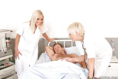 Seductive blonde nurses in nylon nylons sharing a tough boner