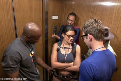 Busty horny brunette gets fucked in group in an elevator