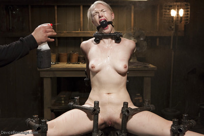 Brave blonde young Ella Nova having pink tongue clamped and shocked