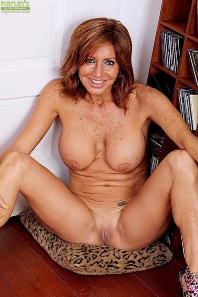 Aged Latin babe pornstar Tara Holiday baring big tits right after upskirt panty second