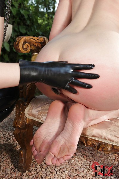 Submissive cutie has some anal fun with her latex clad mistress outdoor