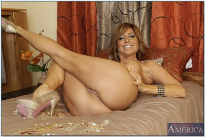 Mature latin chick Tara Holiday showing huge zeppelins and sex-starved pussy
