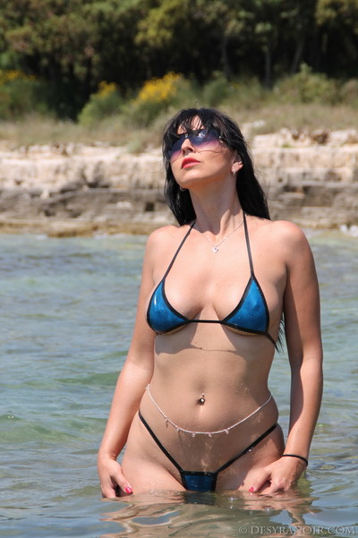Desyra is showing off her perfect body in untamed swimsuit