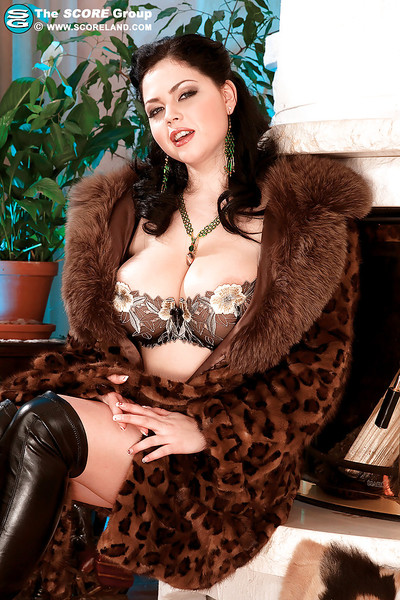 Sticky babe in furs and boots stripping and showing her enormous boobs
