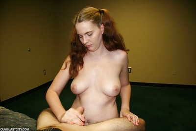 Fuckable adolescent babe with big tits gives a hand gig and gets bukkaked