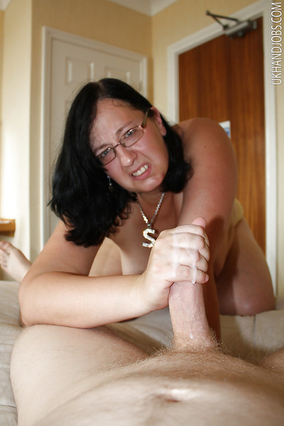 Fatty mellow brunette in glasses striptease and jerking off a big cock