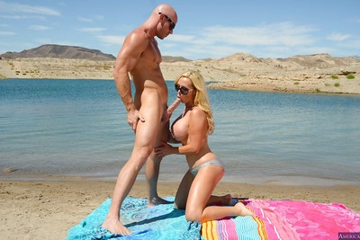 Awesome-looking blonde Nikki Benz is giving a great outdoor dick sucking
