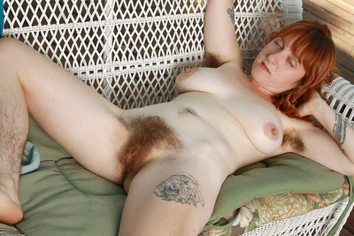 Lusty redhead lassie with bushy legs reveals her saggy jugs and bushy cunt