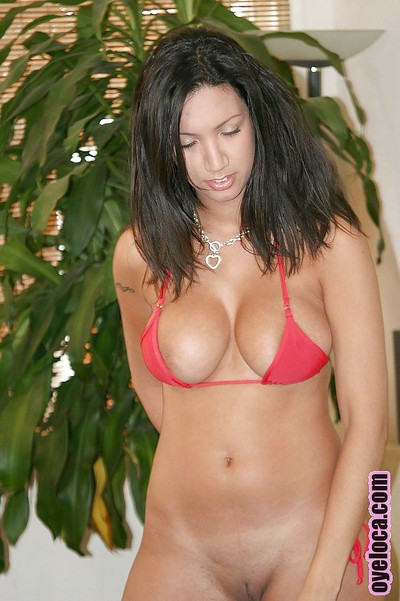 Nasty latina brunette with huge tits Giselle undressing her body