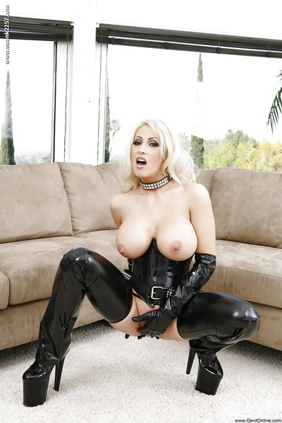 Steamy blond in fetish latex outfit demonstrating her boobs and vagina