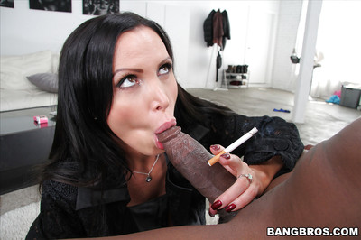 Buxom brunette MILF Nikki Benz giving a huge swarthy cock a tit fucking